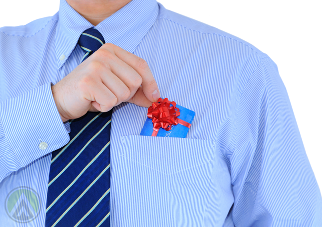 office employee putting tiny gift with ribbon into shirt pocket