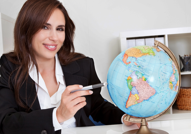 business woman pointing pen on globe