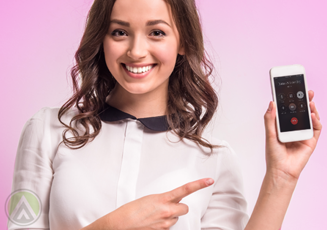smiling woman pointing to smartphone 2