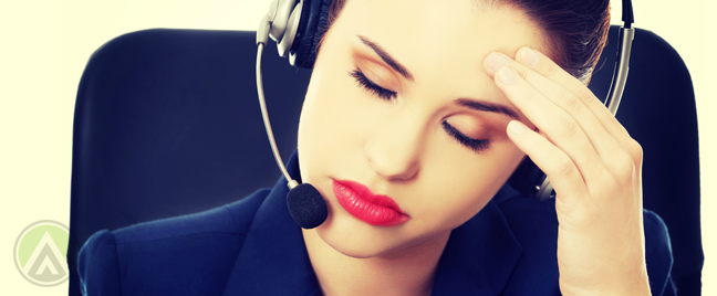 bored customer service call center worker with headache
