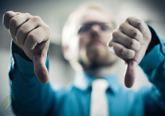 businessman giving thumbs down
