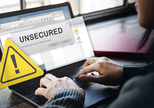woman using laptop with warning signs unsecured data security