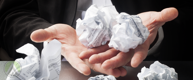 businessman hands holding carrying crumpled paper