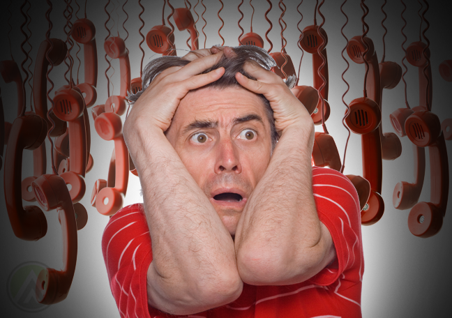 panicking man with red hanging landline telephones in background