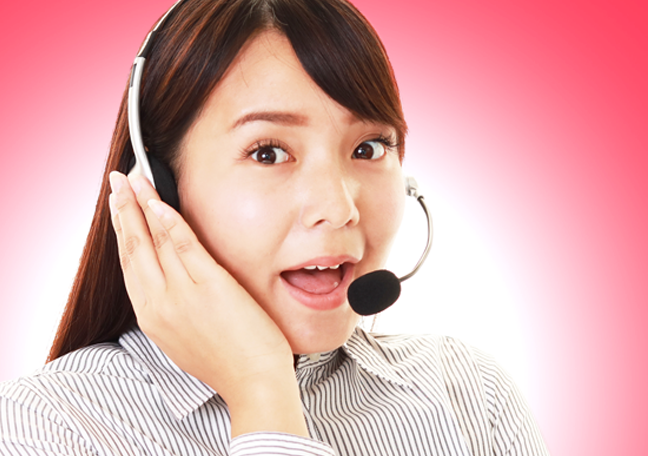 asian call center rep in mid sentence talking to customer on phone