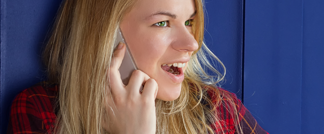 delighted blond woman on the phone