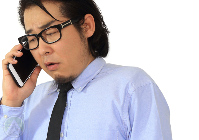 sad worried businessman on the phone