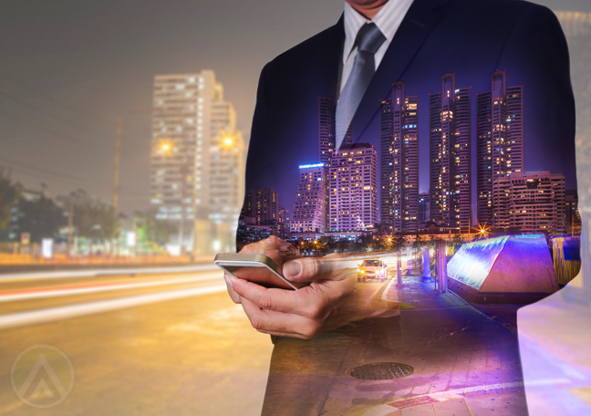 business executive using smartphone in middle of fast highway