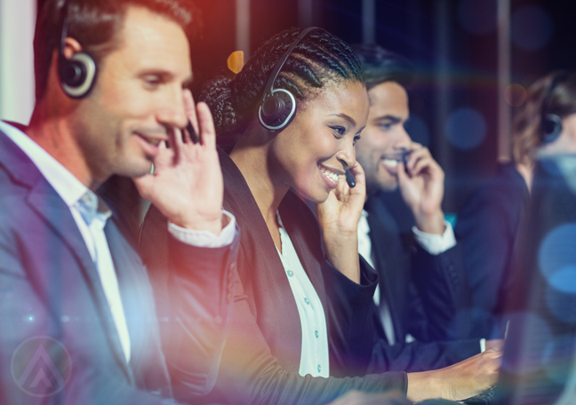 happy diverse customer service at work in call center