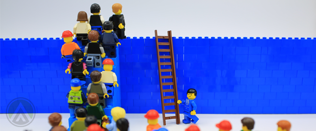 lego minifigs climing ladder over tall blue fence