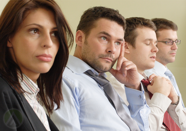 unsure confused sleepy employees in meeting