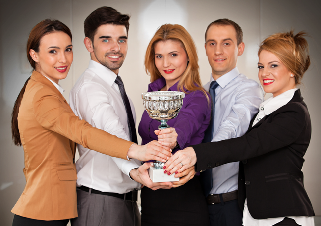 proud office team holding one trophy