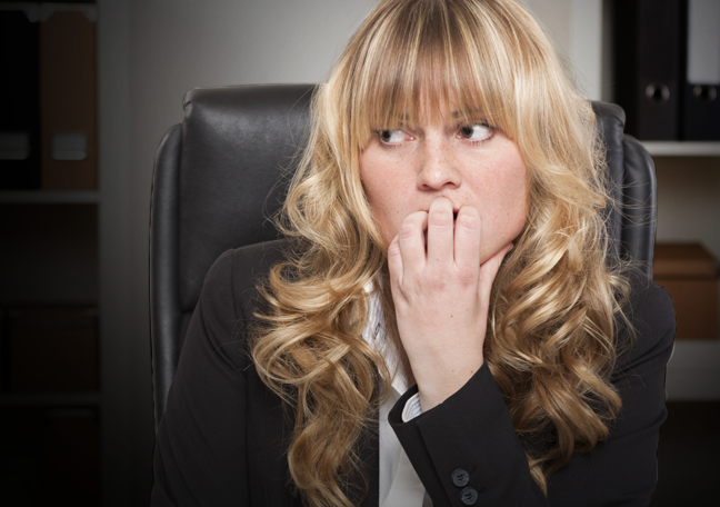 worried business executive biting nails