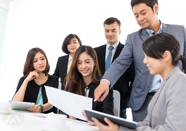 company boss team leader pointing to laptop screen to employees group