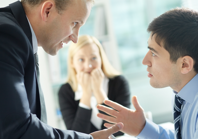 office coworkers arguing worried woman in back