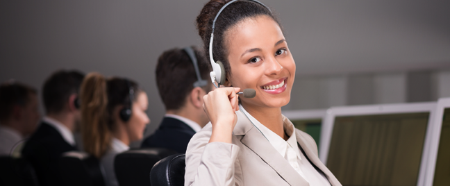 smiling female call center agent next to busy customer service reps