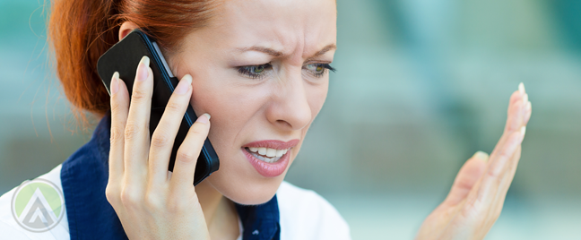 annoyed woman in phone call with customer service agent