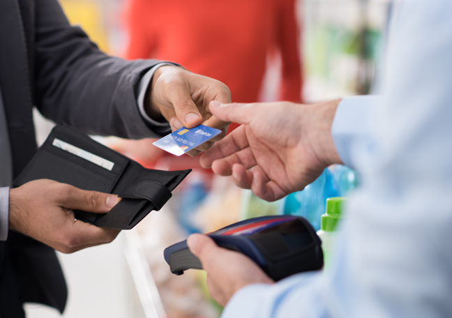 businessman purchasing paying for purchase with credit card