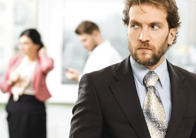 doubtful call center leader looking at coworkers