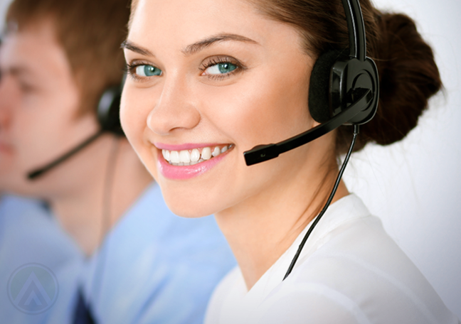 smiling customer service agent in a call center