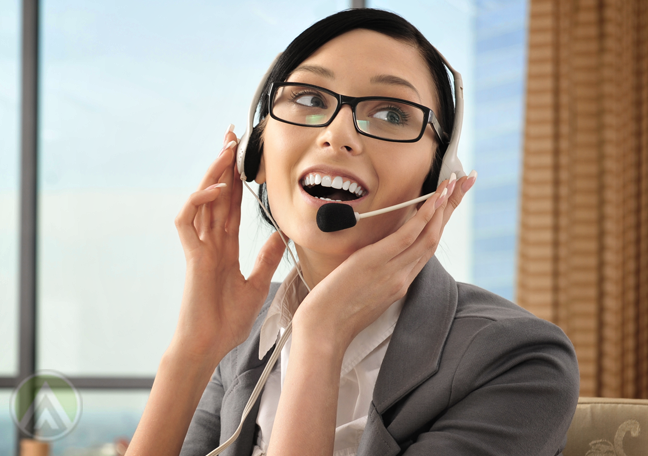 delighted customer support agent speaking to customers on the phone
