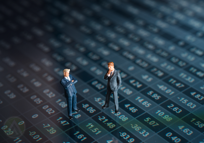 miniature businessman figures standing over tablet screen displaying chart database numbers