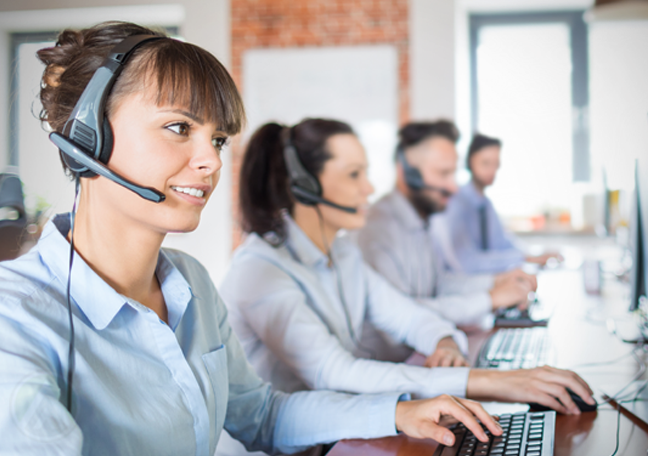 customer support agent with call center coworkers busy at work