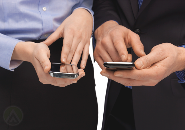 male female business executives using smartphone to read send sms text messages