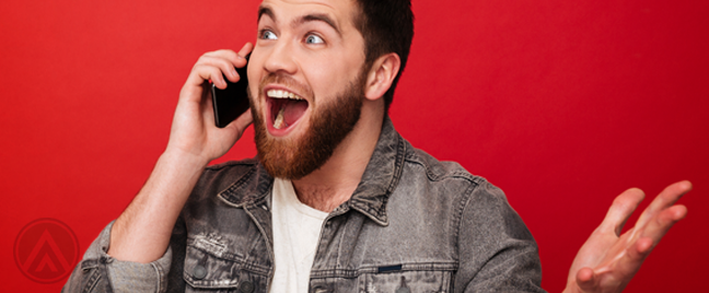 delighted excited man in phone call